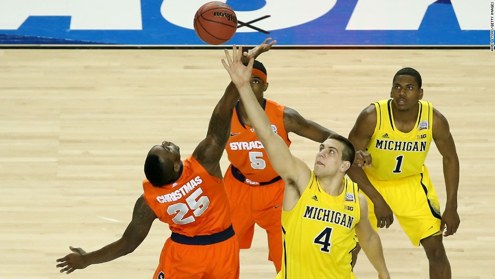 Rakeem Christmas of Syracuse and Mitch McGary, second right, of Michigan go after the ball.