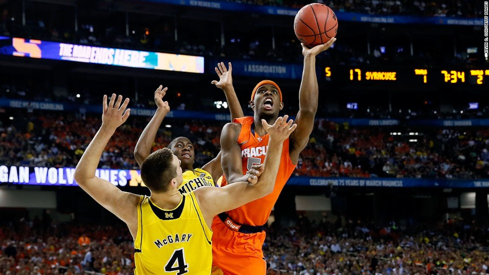 C.J. Fair of Syracuse drives for a shot against Mitch McGary of Michigan.