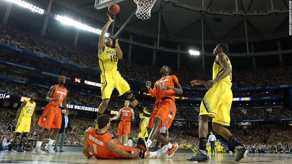 "Jon Horford of the Michigan Wolverines drives for a shot against the Syracuse Orange on Saturday, April 6, in Atlanta in the second of the day's semifinal matchups in the 2013 NCAA men's basketball tournament. Michigan beat Syracuse with a final score of 61-56. Check out the action from the Final Four and <a href=""http://www.cnn.com/2013/04/06/us/gallery/final-four-louisville-wich-st/index.html"" target=""_blank"">look back at the Wichita State-Louisville game</a>."