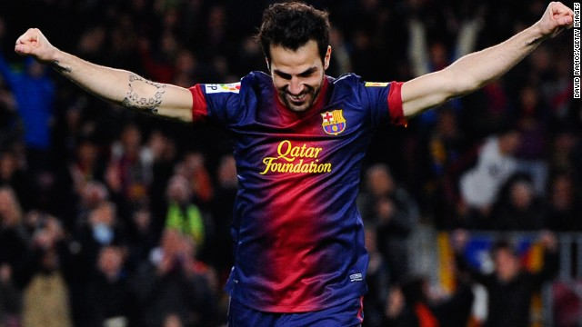 Cesc Fabregas celebrates after completing his hat-trick with Barcelona's fifth goal against Mallorca on Saturday.