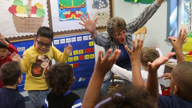 Teacher's assistant Ellen Kitzmiller leads a listening and movement exercise at the federally-funded Head Start school on September 20, 2012 in Woodbourne, NY. (Photo by John Moore/Getty Images)
