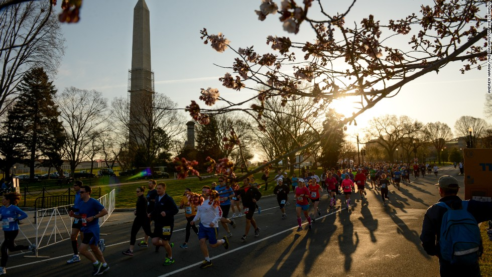 Participants in the Cherry Blossom Ten Mile Run pass near the Washington Monument on April 7.