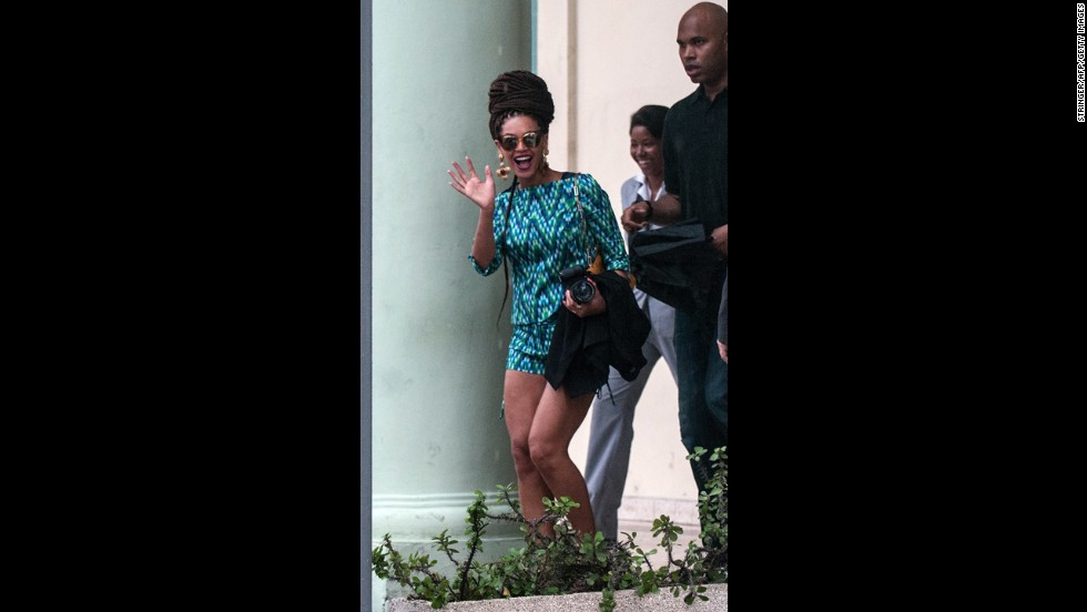 Beyonce waves as she leaves the hotel on Friday.