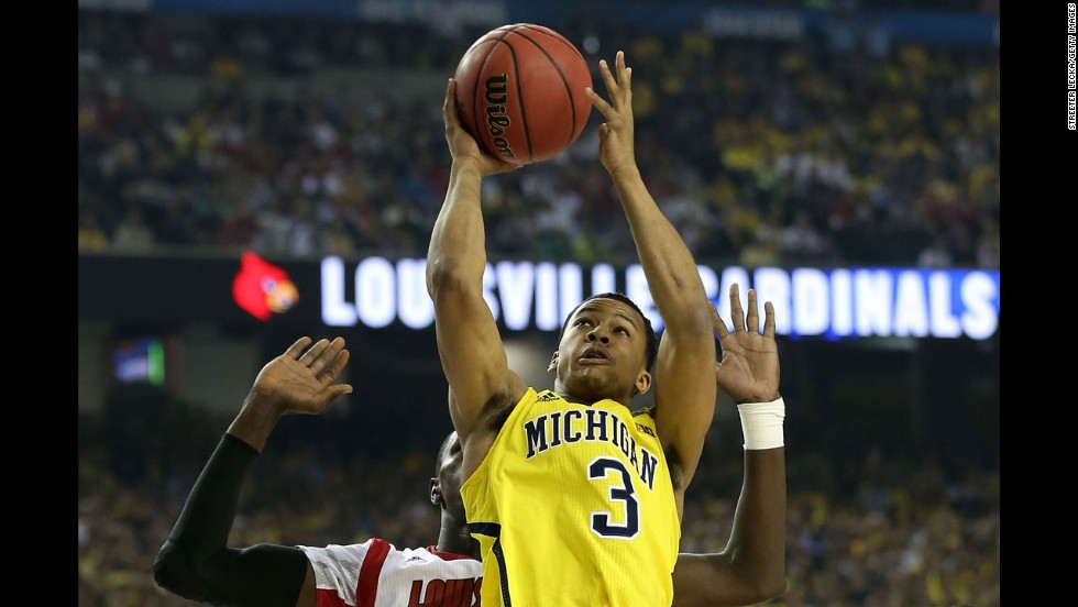 Trey Burke of Michigan shoots for two against Louisville.