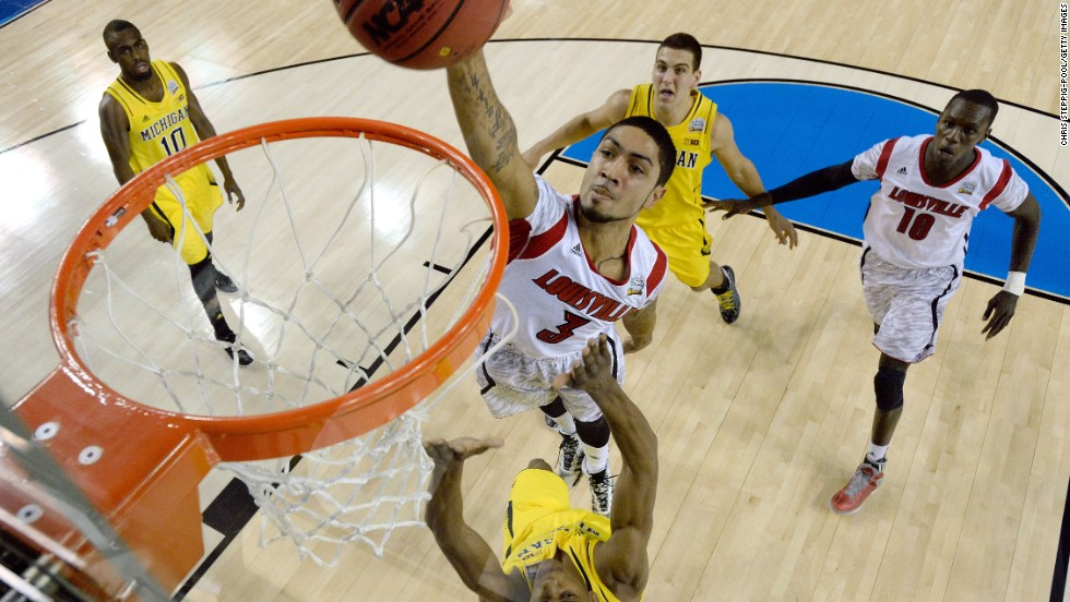 Peyton Siva of Louisville attempts a dunk.