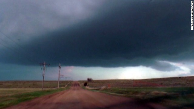 Tornado darkens sky, touches down