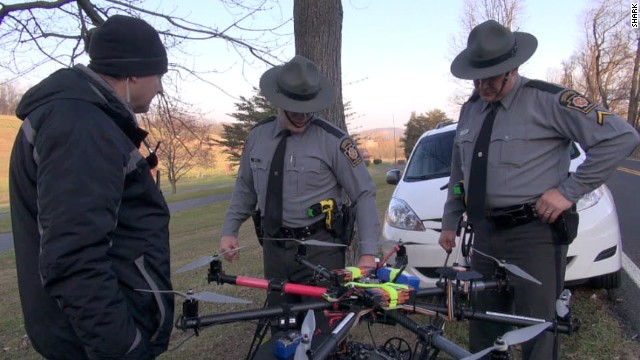 Officers inspect a drone launched by animal rights group SHARK after it was shot down in November in Pennsylvania.