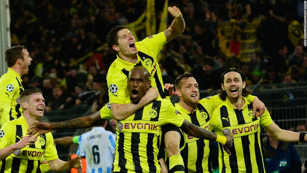 Dortmund's players celebrate their famous 3-2 victory over Malaga and will now look forward to the semifinals where it could be joined by fellow German club Bayern Munich.