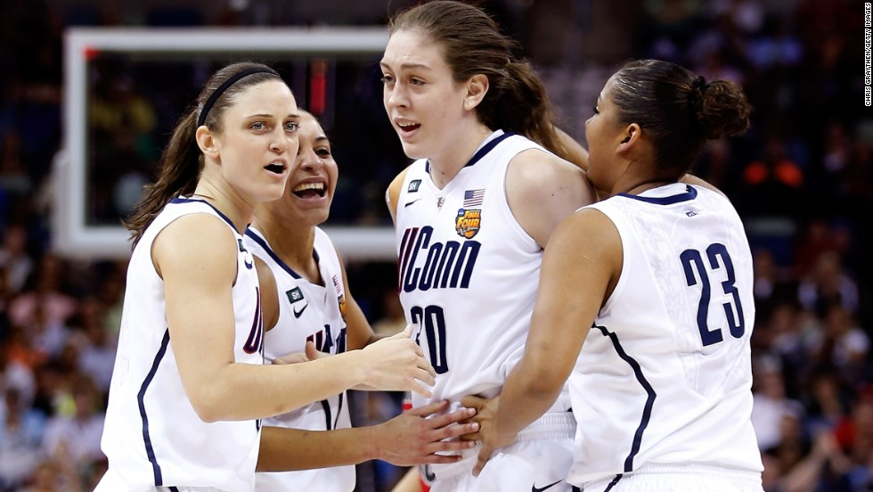 Breanna Stewart of UCONN celebrates with teammates after a play in the first half against Louisville during the title game on April 9.