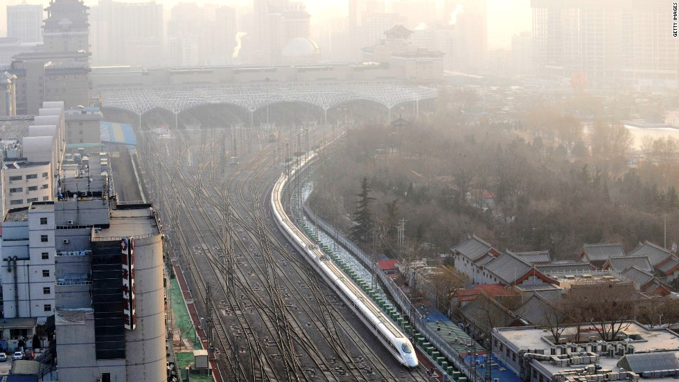 A train leaving Beijing West Rail Station. The world's longest high-speed rail line links Beijing and Guangzhou, China's southern hub 2,300 kilometers away.