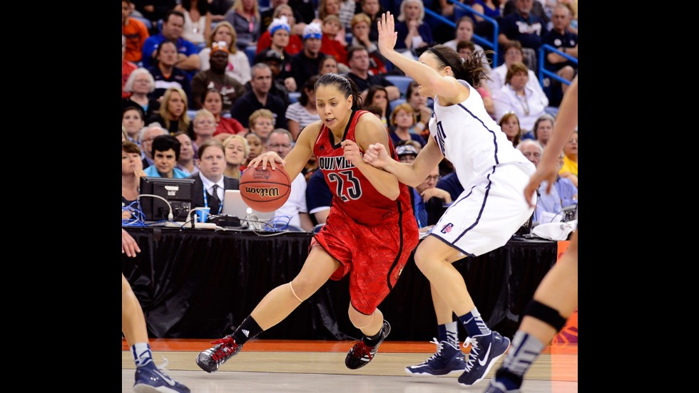 Shoni Schimmel of Louisville drives with the ball against Kelly Faris of UCONN on April 9.