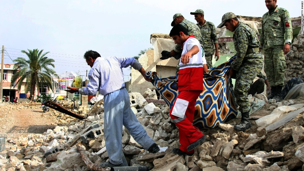 Iranian soldiers and aid workers help a man carry his belongings from his house in Shanbeh on Wednesday, April 10, after a powerful earthquake destroyed it. The magnitude-6.3 quake struck southern Iran on Tuesday, April 9, killing at least 37 people, Iranian state-run media reported. The temblor was centered more than 60 miles southeast of the Bushehr nuclear plant, but Iran's Press TV said the single-reactor facility was undamaged.