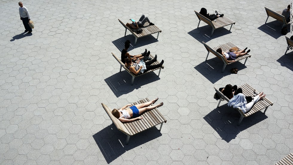 Warm spring weather finds New Yorkers relaxing along the East River in Lower Manhattan on Tuesday, April 9.
