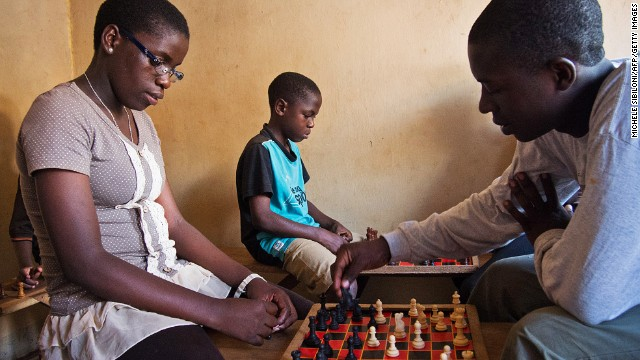 16 year old Phiona Mutesi (L) plays at a chess centre in Kampala on January 17, 2013.