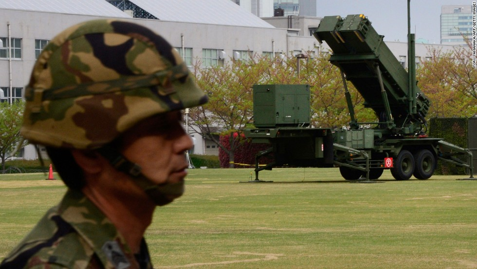 A Japanese soldier is on alert as Patriot Advanced Capability-3 missile launchers are deployed at the Defense Ministry in Tokyo on Wednesday, April 10.