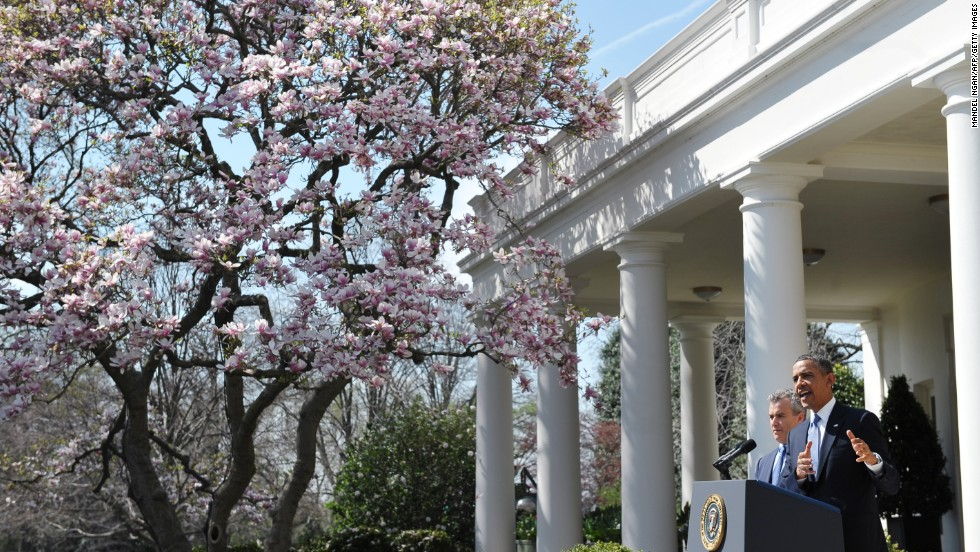 President Barack Obama gives a speech under a cherry tree at the White House on Wednesday, April 10, in Washington.