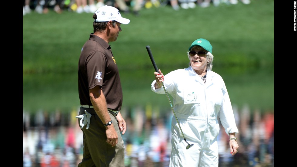 Lee Westwood of England's mother, Trish, hands her son a putter.