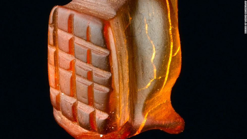 A complete amber Gladiator amulet. Seven meters of archaeology have been excavated, including remains covering the entire Roman occupation of Britain -- from the mid 40s AD to the early 5th century.
