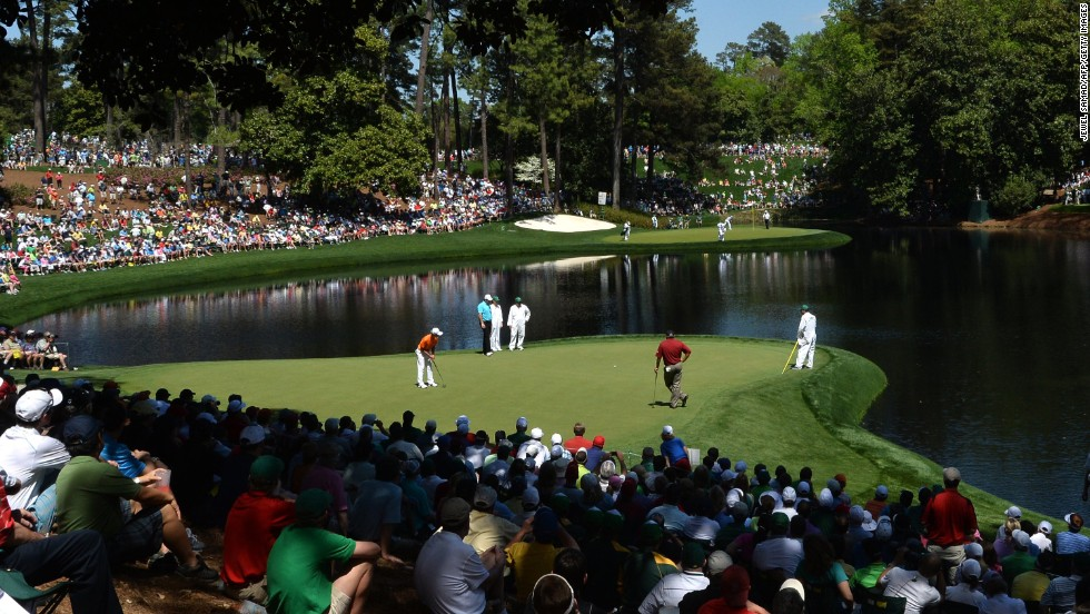 Tianlang Guan of China putts. Guan, 14, will become the youngest player in Masters history.