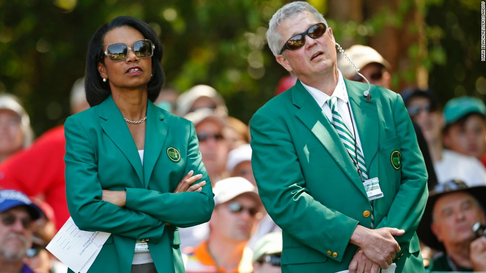 Condoleezza Rice, former U.S. secretary of state and new member of Augusta National Golf Club, looks on with member Bruce A. Lilly of Minnesota during the annual Masters Par 3 Contest.