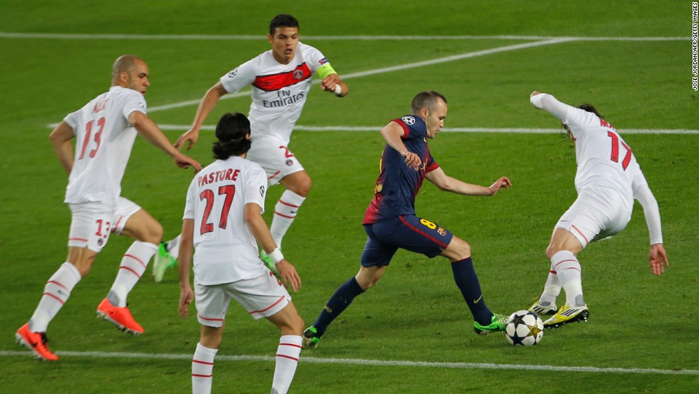 Andres Iniesta is surrounded by PSG defenders during a frantic first half at Camp Nou. Both teams pushed forward in a contest played at rapid pace.