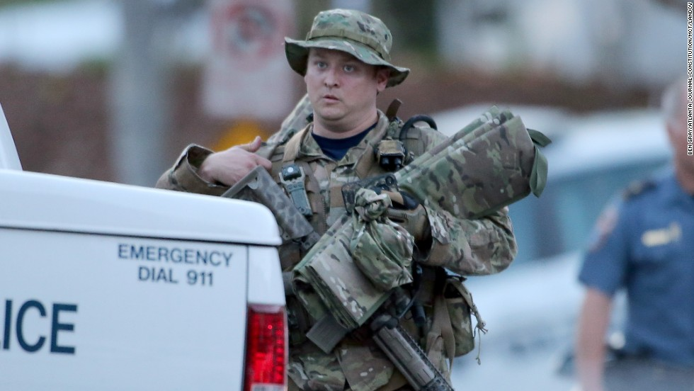 A SWAT team member heads to his car after the standoff. One law enforcement officer was shot in the incident, but his injury is not considered life-threatening, officials said.