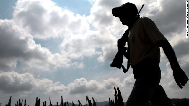 Armed residents search for criminals in the village of Xaltianguis, Acapulco municipality, on April 2, 2013.
