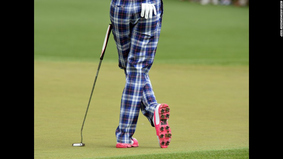 Ian Poulter of England pauses during the first round.