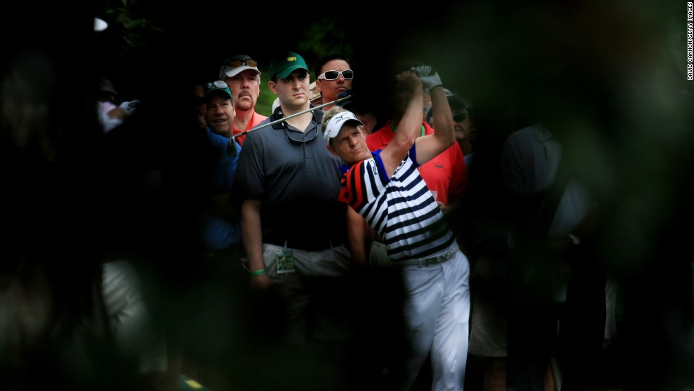 Luke Donald of England hits his second shot on the fifth hole.