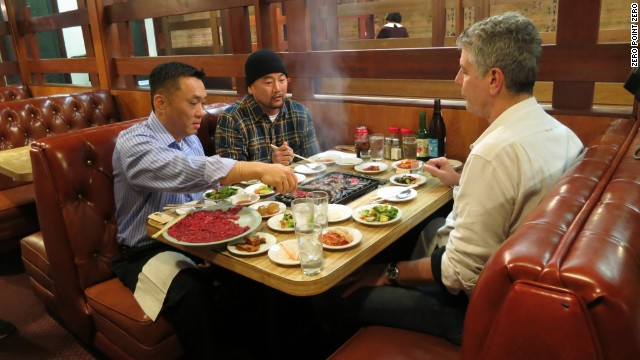 Anthony Bourdain shares a meal with chef Roy Choi and restaurant owner Roy Kim at Dong Il Jang in the Koreatown neighborhood of Los Angeles.