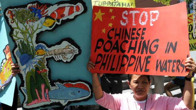 Protesters display placards during a rally in front of the Chinese consular office in Manila on April 11.