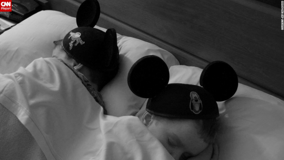 """Jay Callaghan's family went to Walt Disney World in 2009 and returned two years later, with the kids' mouse ears making the return trip. """"Somehow they managed to survive the two years in the house with ears taken off,"""" said the Peterborough, Ontario, resident. """"We managed to get some shots with them wearing the ears, but by far my favorite shot is the one of them at the Disney All Star Movies Resort while they were <a href=""""http://ireport.cnn.com/docs/DOC-953457"""">all tuckered out </a>from a full day at the Magic Kingdom."""""""