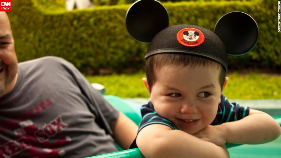 "Photographer and Disneyland annual pass-holder Austen Risolvato just had to capture a friend's son's <a href=""http://ireport.cnn.com/docs/DOC-954794"">first visit</a> to the park. ""The mouse ears to me are an iconic image. They represent a message to me that nothing is impossible."""