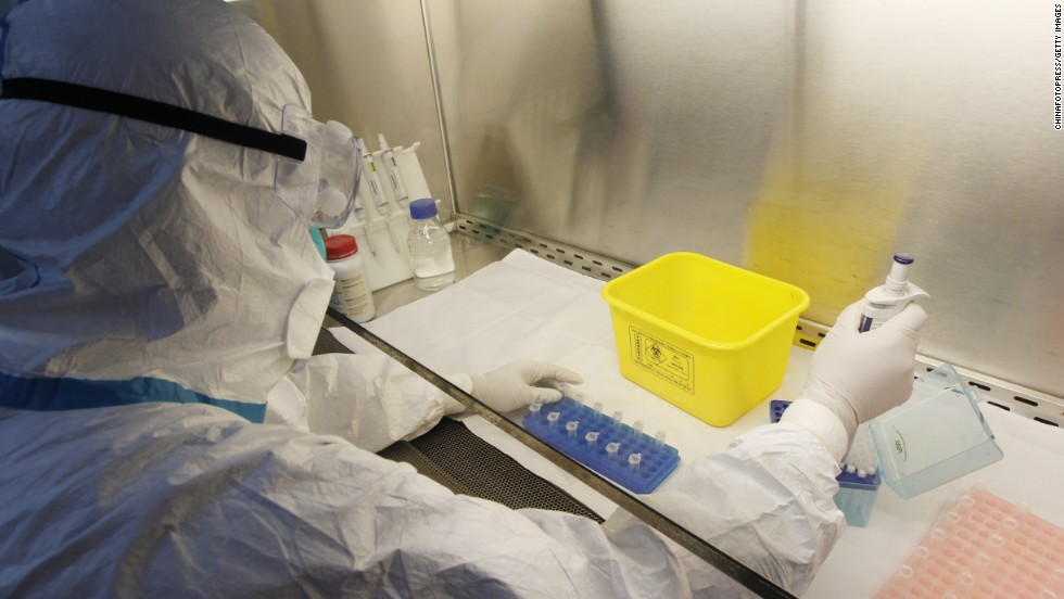 A technician conducts tests for the H7N9 bird flu virus at the Kunming Center for Disease Control on April 10 in Kunming, China.