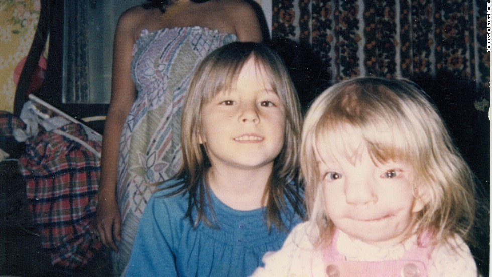 Loker and her sister Crystal as children.