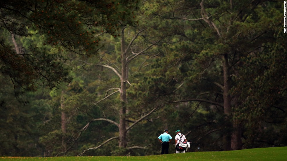 Mark O'Meara and caddie Shane Joel stand on the second fairway.