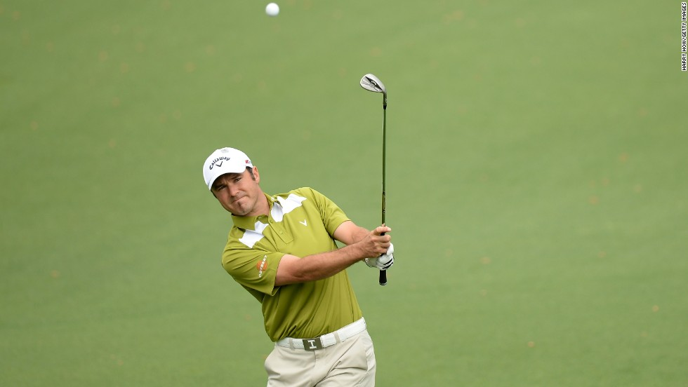 South Africa's Trevor Immelman chips onto the second green on April 12.