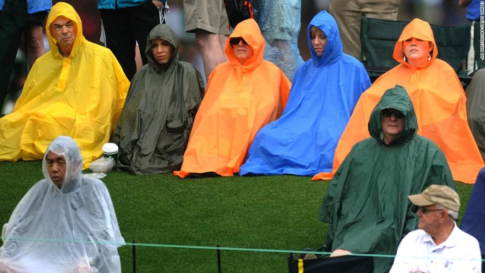 Fans watch play in the rain.