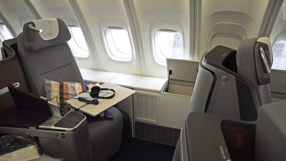 Lufthansa's business-class seat can be flattened to make a 1.98-meter bed. It felt a little snug for our 188 cm model (wearing shoes), but lowering arm rests and a hollow center console added to the comfort. Lufthansa says 1,340 passengers tested its new seat.