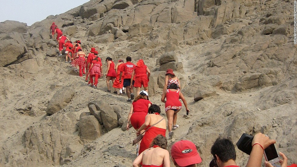 This traditional Red Dress Run covers rocky terrain in Peru.