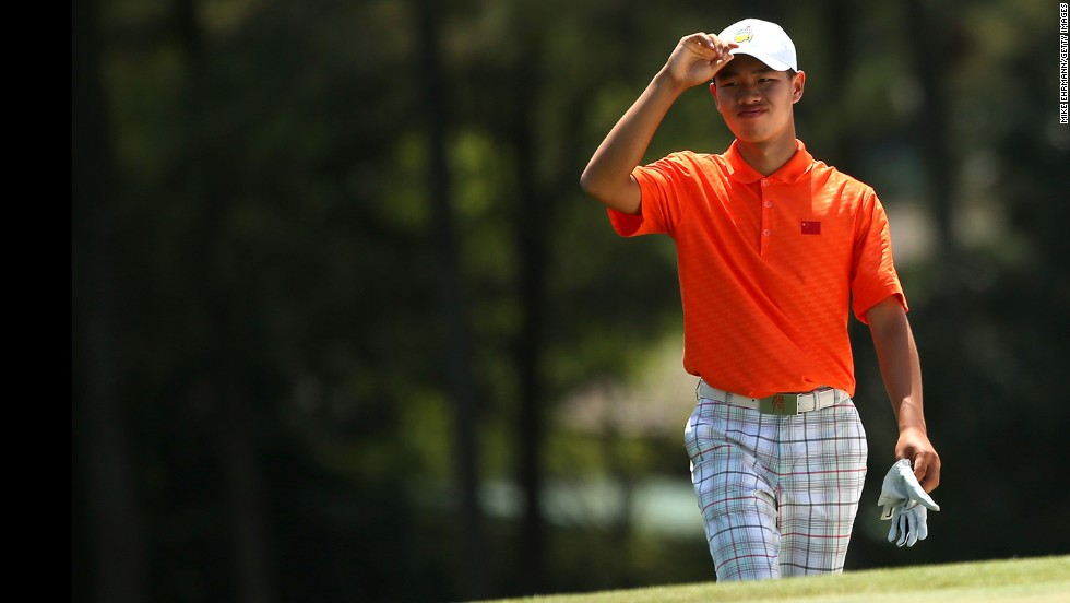 Tianlang Guan of China walks up the 18th fairway during the second round. Guan was given a one-shot penalty following his second shot on the 17th hole for exceeding the 40-second time limit.