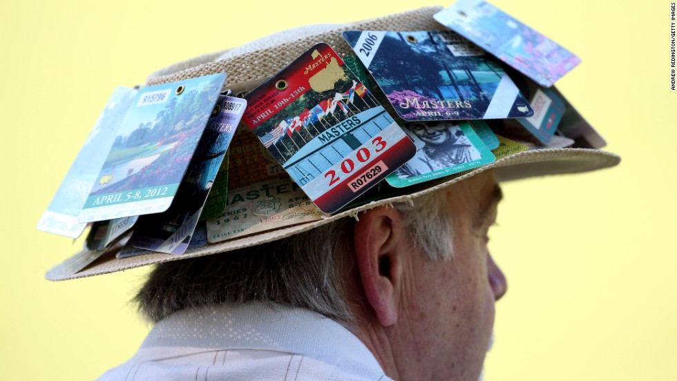 A man watches the third round of the 2013 Masters Tournament.