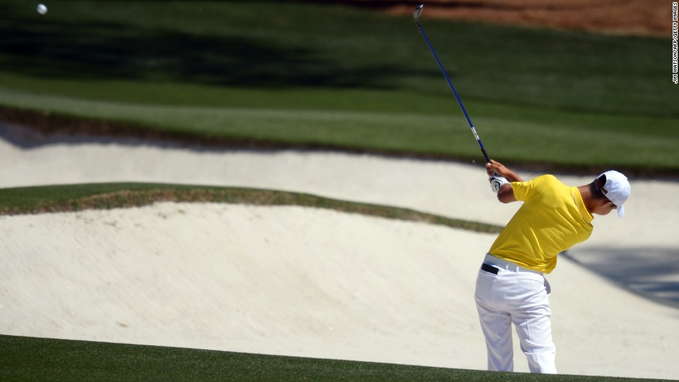 Guan Tianlang of China plays during the third round.