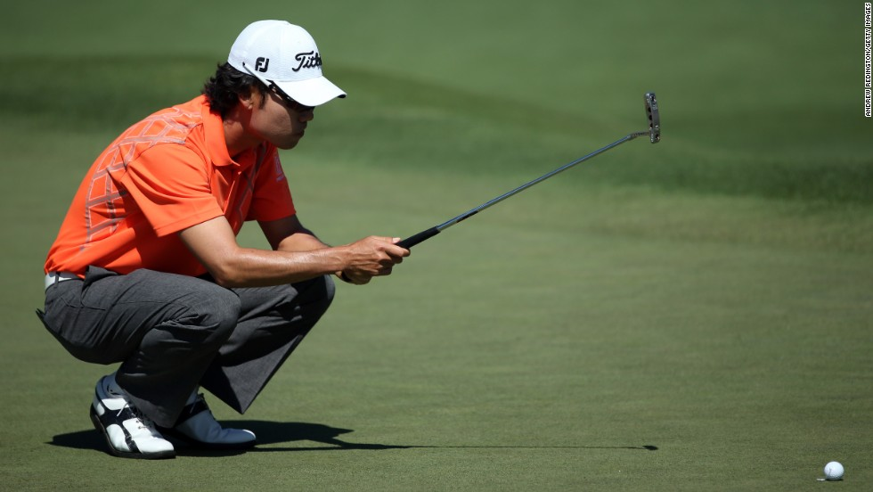 Kevin Na of the U.S. lines up a putt on the second hole.