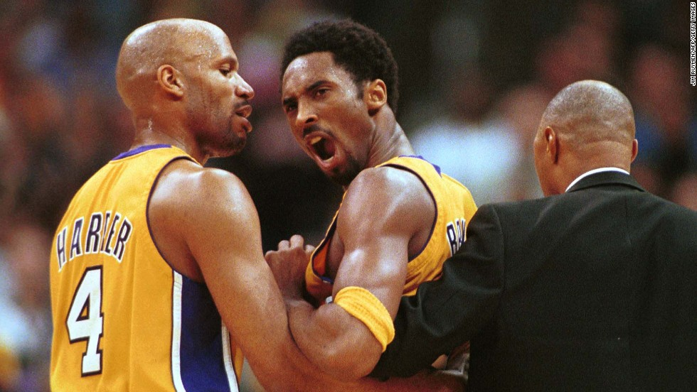 Bryant, center, is restrained by teammate Ron Harper, left, and assistant coach Jim Cleamons after a confrontation with New York Knicks guard Chris Childs on April 2, 2000, at Staples Center. Both players were ejected and the Lakers went on to defeat the Knicks 106-82.