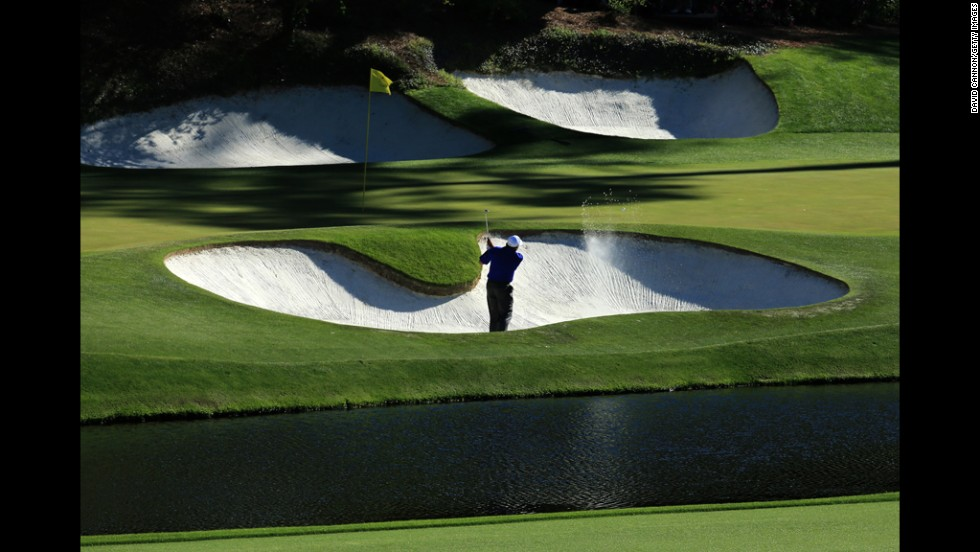 Angel Cabrera of Argentina plays his second shot on the 12th hole.