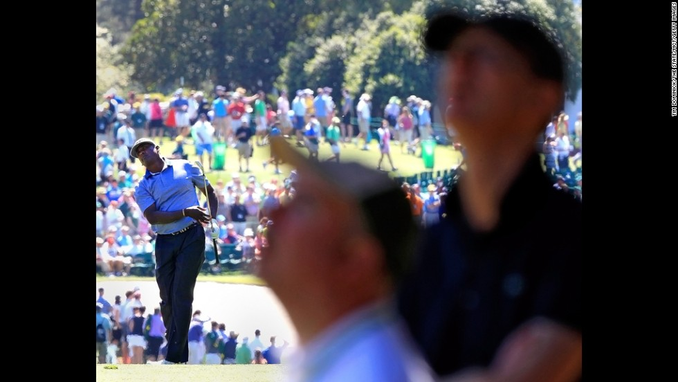 Vijay Singh watches his approach shot to the first green.