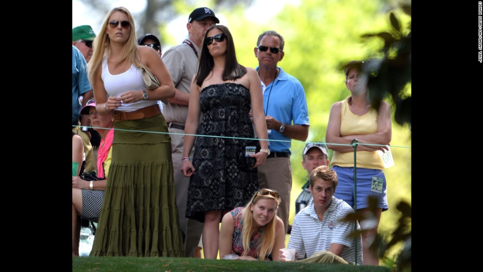 Lindsey Vonn watches Tiger Woods of the United States.