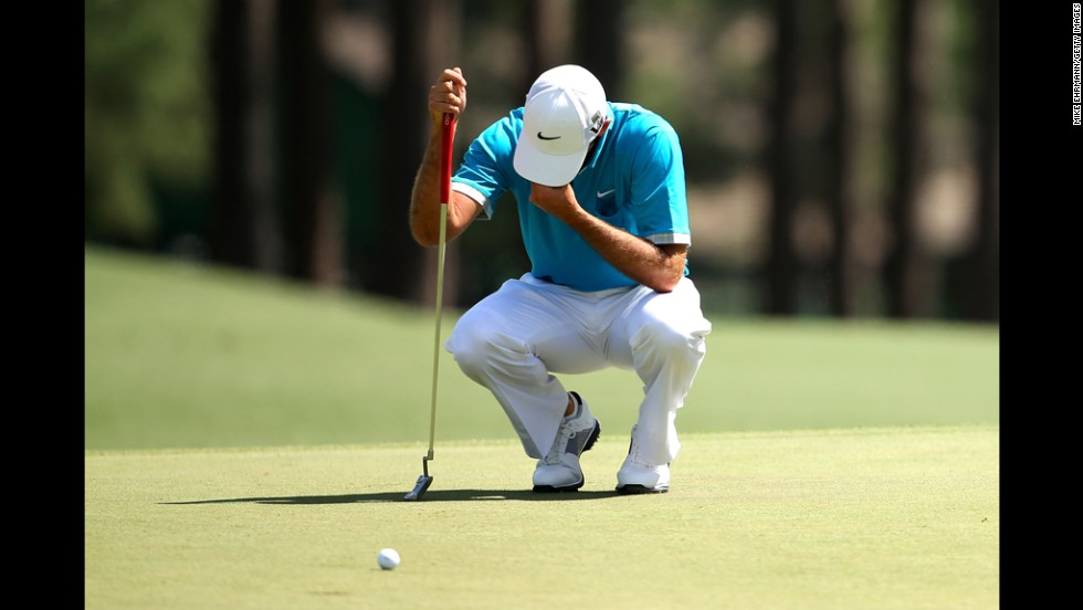 Charl Schwartzel of South Africa reacts after missing a birdie putt on the eighth hole.
