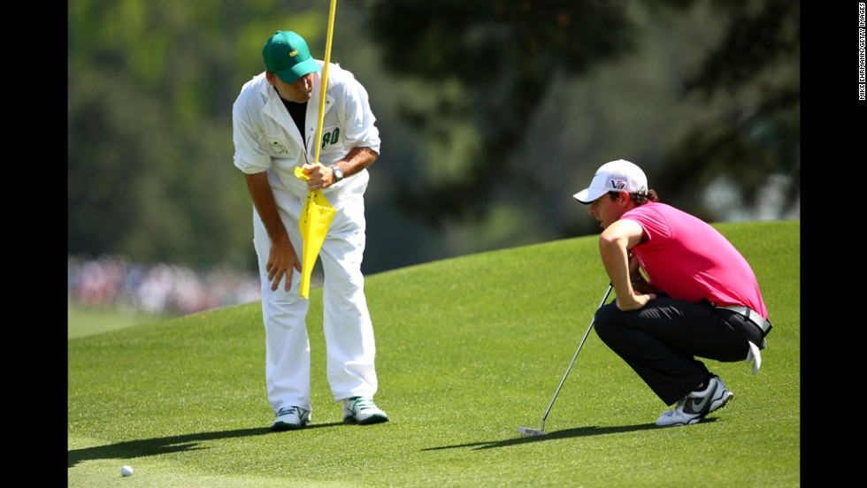 Rory McIlroy of Northern Ireland lines up a putt on the eighth hole.